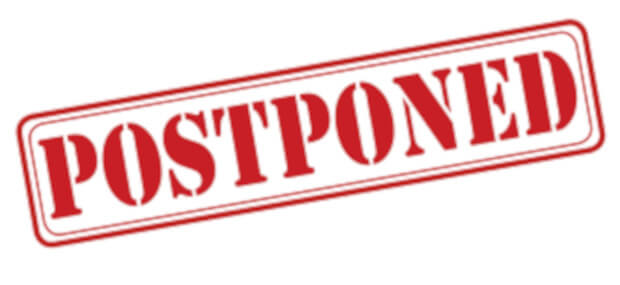 The word Postponed stamped in large red and bold letters