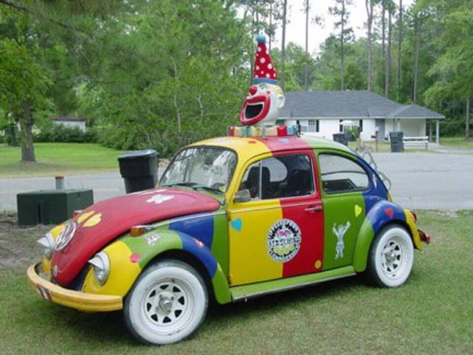 a clown car on a grassy field