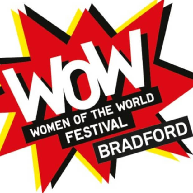 Women of the World logo, red star over yellow star, like a bang effect