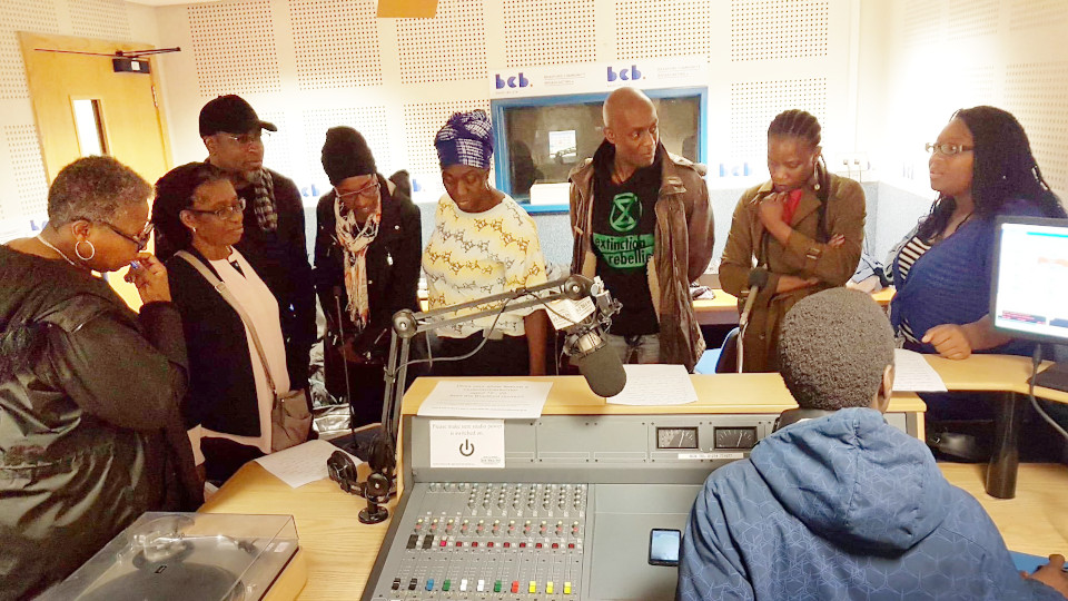 A group of people around the radio desk