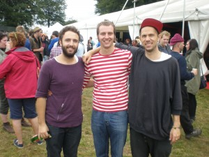 Some bloke dressed as Where's Wally and looking as gay as a window with Andy & Kelcey from Local Natives.