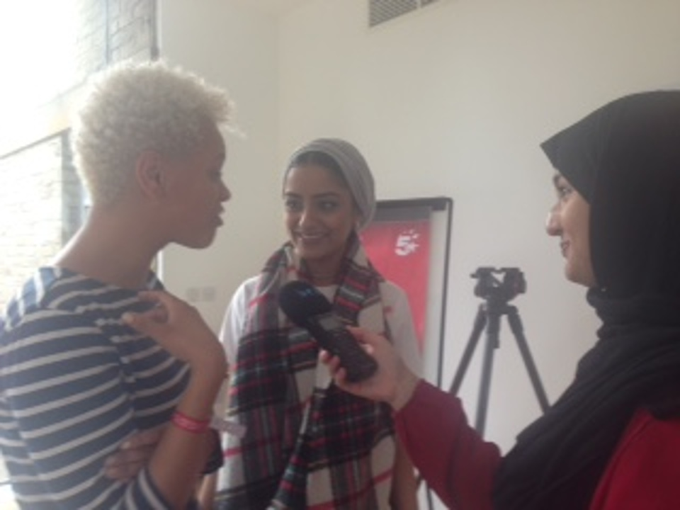 2 women interviewing another woman