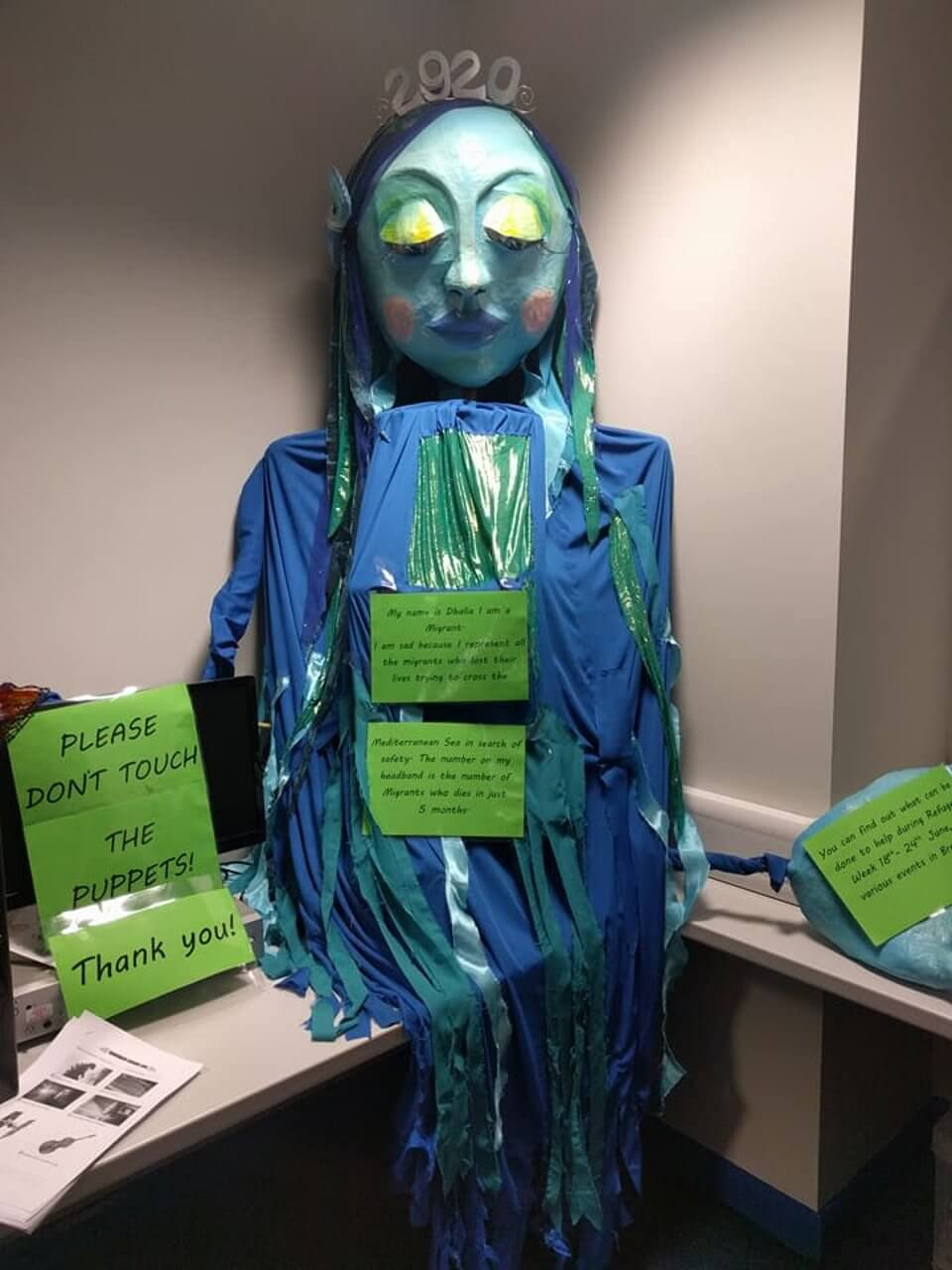 A scary green puppet