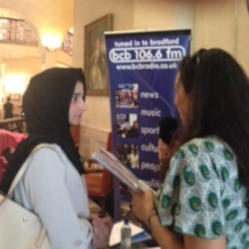 a bcb volunteer interviewing a lady in a hijab