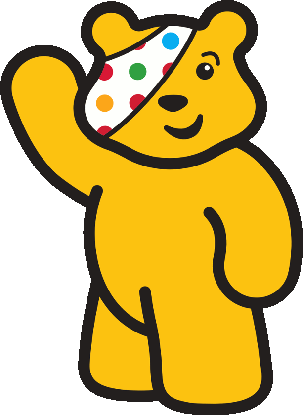a yellow stuffed bear with colourful eyepatch