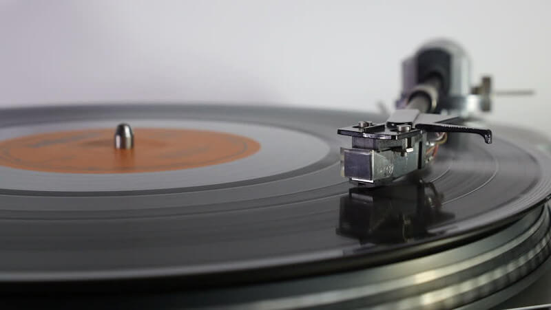 Close up view of a turntable and stylus playing a record