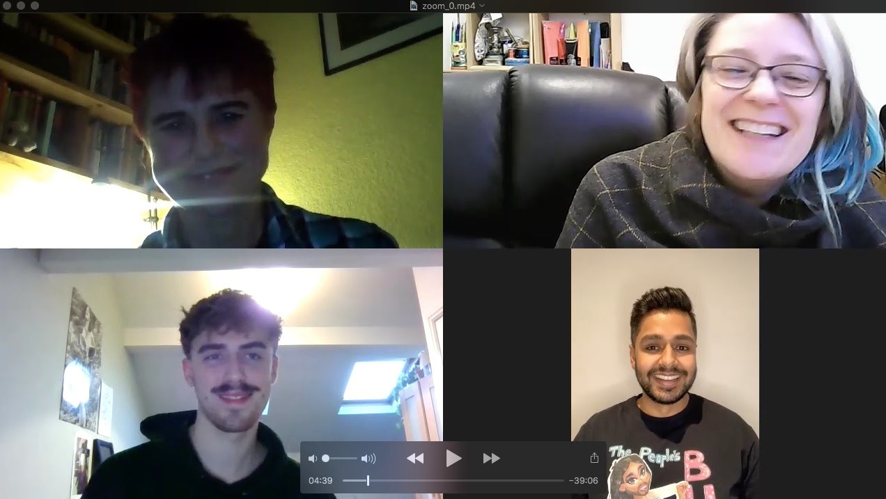 A zoom call photo of 4 people within their separate screens having a virtual conference and smiling at each other