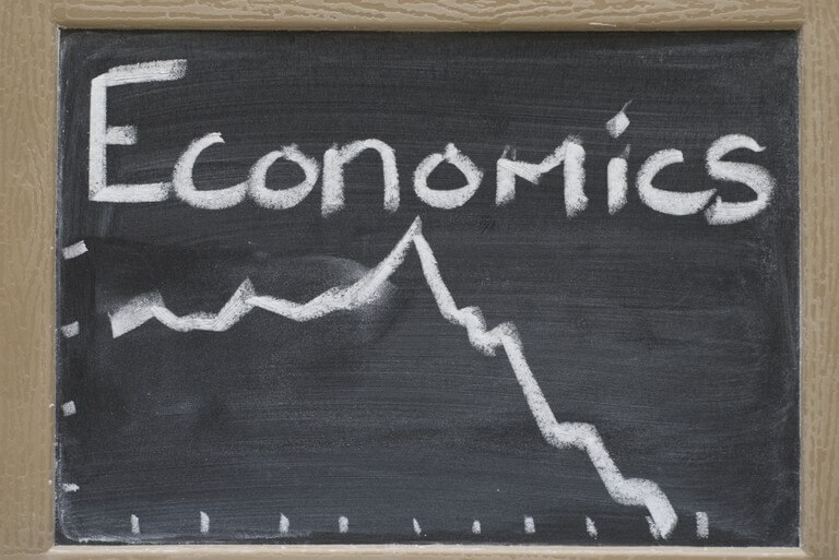 a blackboard with economics in chalk